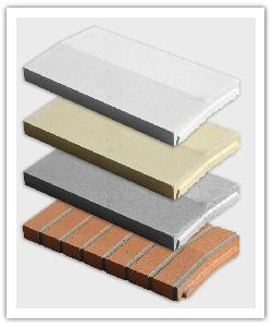 Optipose weathered interlocking wall copings - off-white, bathstone, grey and brick colour  - in reconstructed stone
