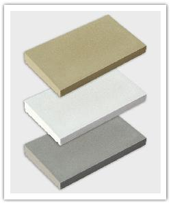 Dry-cast single weathered copings - bathstone, off-white, and grey - in reconstructed stone