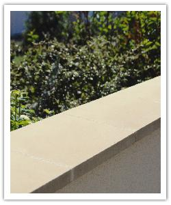 Dry-cast single weathered copings - bathstone - in reconstructed stone